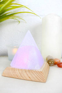 White Himalayan colour changing salt lamp, pyramid shape on wooden base. Powered by USB device, connect using attached USB lead.