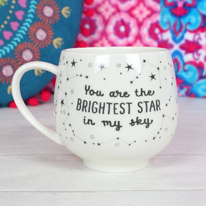 """You are the brightest star in my sky"" slogan mug with constellation pattern on a white ceramic mug."