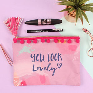 "Pink pastel make up & toiletries bag with ""You Look Lovely"" slogan print and pink tassel zip and pompom detail."