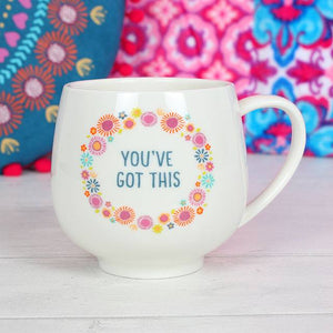 "Inspirational coffee cup with ""You've Got This"" slogan and pretty, colourful floral pattern on both sides."