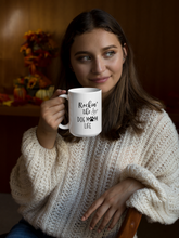 Load image into Gallery viewer, Girl holding a mug that reads Rockin the Dog Mom Life