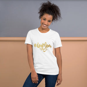 White Shirt that reads #DogMom on it in gold text.
