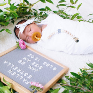 Baby girl arrival pictures with letter board and grey white cream binky clip Harbor Crochet Wood Bead Pacifier Clip - Late Night Luna
