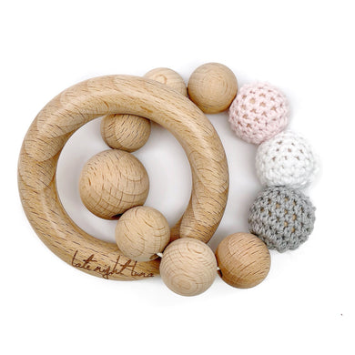 Our Wood Bead Teething Toys are made from 100% natural material including organic wood beads, cotton yarn and waxed cotton cord. Completely natural and eco-friendly, each toy is double strung on strong cotton cord to ensure safety and durability. Your baby will love the rattling sound this teething toy makes when shook and the soothing relief he/she gets on those sore teething gums!