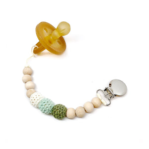 Sage Organic Wood Bead Pacifier Clip made by Late Night Luna. This beautiful earthy green boho dummy clip is a wonderful gender neutral gift! Certified safe, this high quality gift is a win for any baby shower!