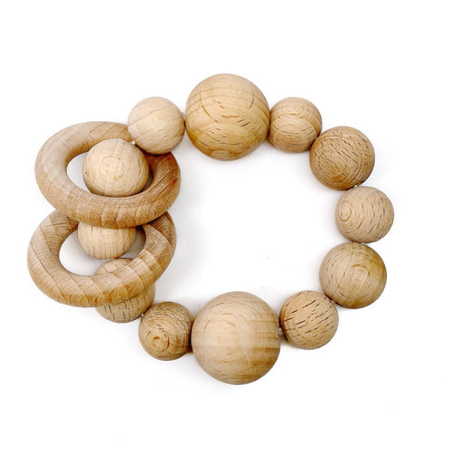 At Late Night Luna our Wood Bead Teething Toys are made from 100% natural material including organic wood beads and waxed cotton cord. Completely natural and eco-friendly, each toy is double strung on strong cotton cord to ensure safety and durability. Your baby will love the rattling sound this teething toy makes when shook and the soothing relief he/she gets on those sore teething gums!
