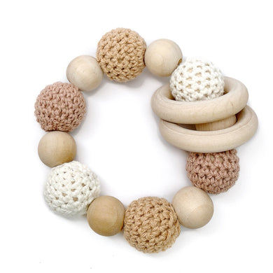 Late Night Luna Organic Wood Teething Toy These are great Montessori inspired toys, make excellent baby rattles / infant rattles, and are perfect for nursing babies! These little teething rings are safe and chemical free!