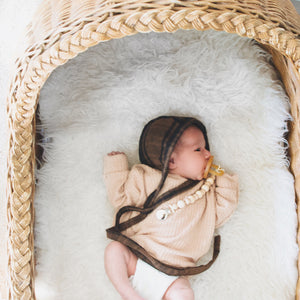 Baby in big basket with Chunky Wood Bead Pacifier Clip - Late Night Luna