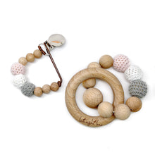 Celeste is part of our beech wood bead collection and is made of beautiful neutral color crochet wood beads double strung on strong brown waxed cotton cord. Your baby's safety is our number one priority which is why all of our teething toys and pacifier clips have been lab tested and are certified CPSC safe! This testing includes chemical and use and abuse testing.