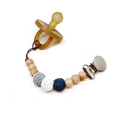Our Organic Wood Bead Pacifier Clips are made from natural material including organic beads, waxed cotton cord and a LEAD FREE metal clip! Your baby's safety is our number one priority which is why all of our teething toys and pacifier clips have been lab tested and are certified CPSC safe!