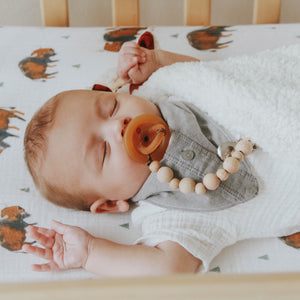 Be home Wood Bead Pacifier Clip by Late Night Luna This wood bead pacifier clip is made from natural Beech wood beads. Beech wood is high quality hard wood that has natural wood marbling throughout each bead. Strung on a brown waxed cotton cord this clip has a wonderful earthy and natural appeal with a classic and vintage look!