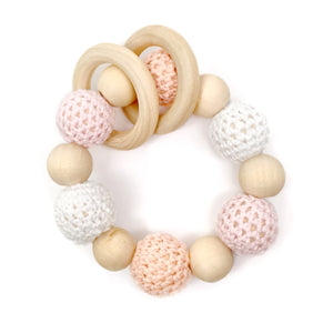 Blush Crochet Wood Bead Teething Toy Blush is a beautiful ombre of pinks and white. This wood bead teething toy is made from natural materials and safe for baby! Take those toxic plastics out of your baby's mouth and give them something natural to get them through the teething stage.  - Late Night Luna