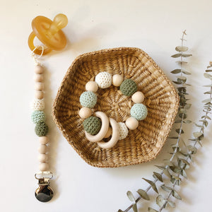 Sage Organic Wood Bead Pacifier Clip & Matching Teething Toy Gift Set by Late Night Luna. Each Gift Set comes boxed and ready to give! So whether it is for your baby, a dear friend's baby shower or you are looking for the perfect first holiday gift for a little in your life, this wonder set is sure to be best in show.