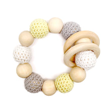 Dandelion Crochet Wood Bead Teething Toy, with its bright white, soft yellow and beautiful grey is both beautiful and functional! Environmentally friendly, this wood toy helps relieve sore gums while keeping those little hands occupied! Made and sold by Late Night Luna