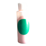 Small plastic cylinder filled with green concentrated color.