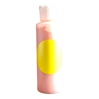Small plastic cylinder filled with yellow concentrated color.