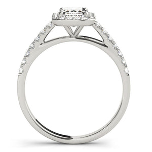 Four-Prong Halo Emerald Platinum Engagement Ring