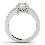 Four-Prong Halo Emerald 14K White Gold Engagement Ring