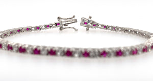 1 CT. TW. Lab Created Round Ruby & White Sapphire Bracelet in Sterling Silver