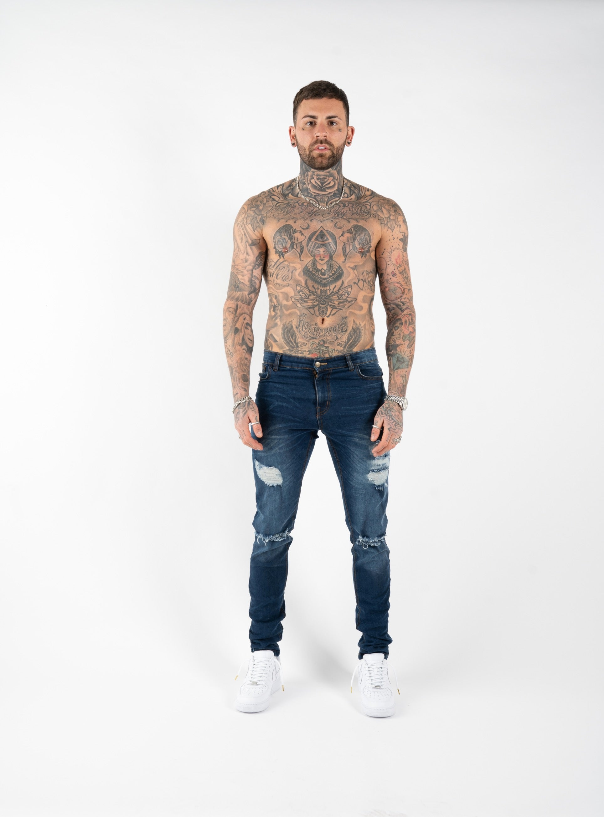 SPRAY ON RIPPED AND REPAIRED JEANS - BLUE