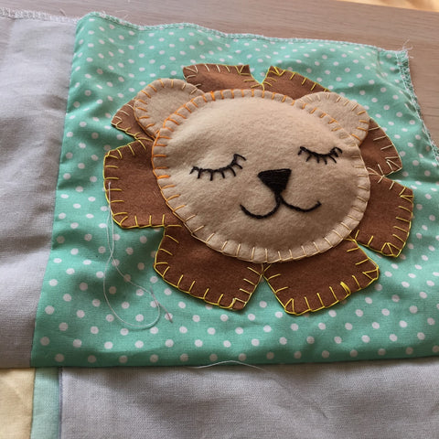 hand sewing applique lion