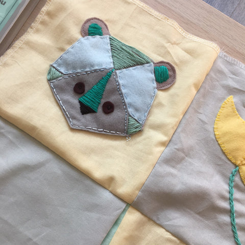 hand sewing embroidered bear applique