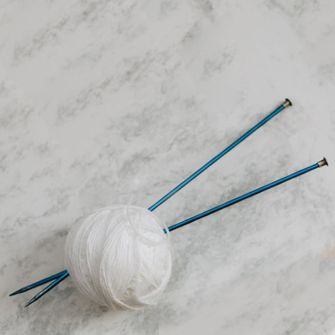 Knitting needles and ball of wool ready for our knitting class for beginners at workshop headingley