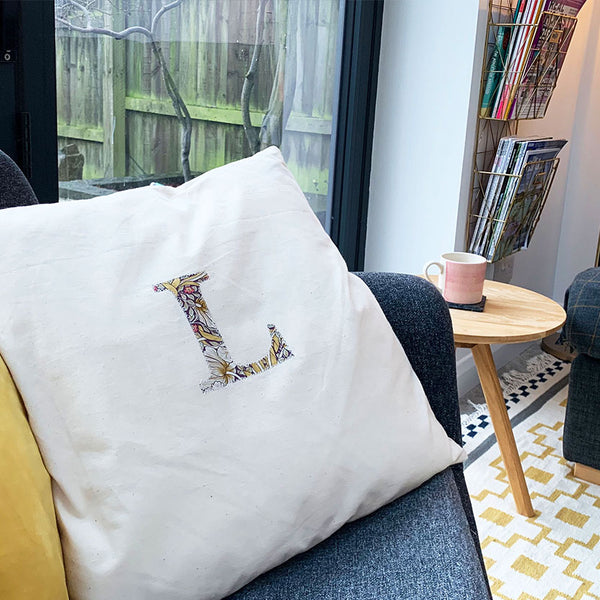 cushion cover with appliqued initial L