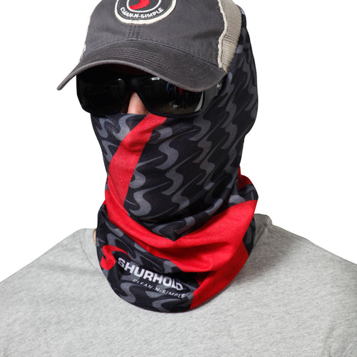 Man wearing black and red bandanna around face
