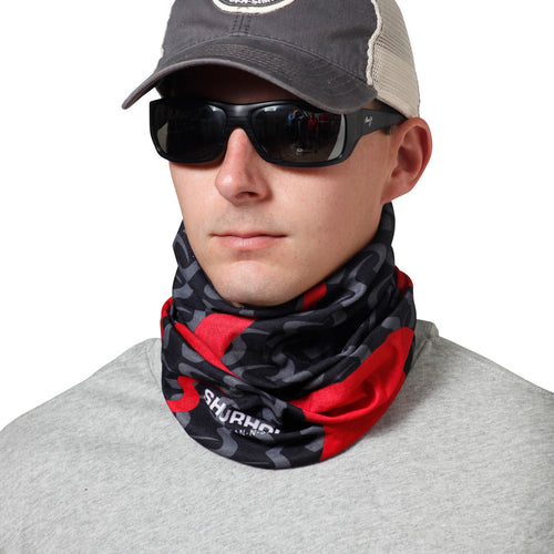 Man wearing black and red bandanna around neck