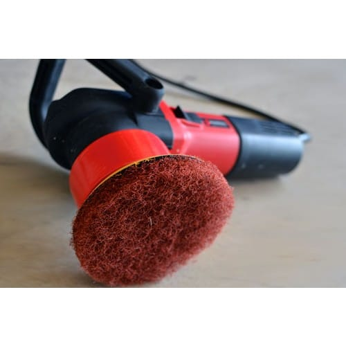 Shurhold DAP Scrubber Pad attached to Dual Action Polisher