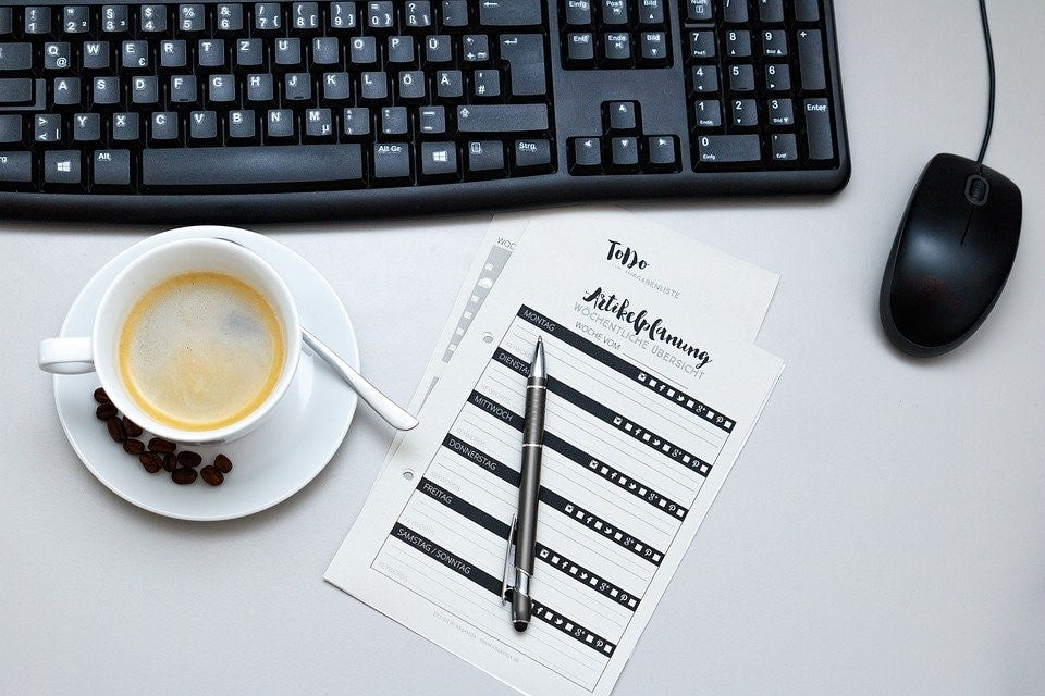 coffee next to a keyboard