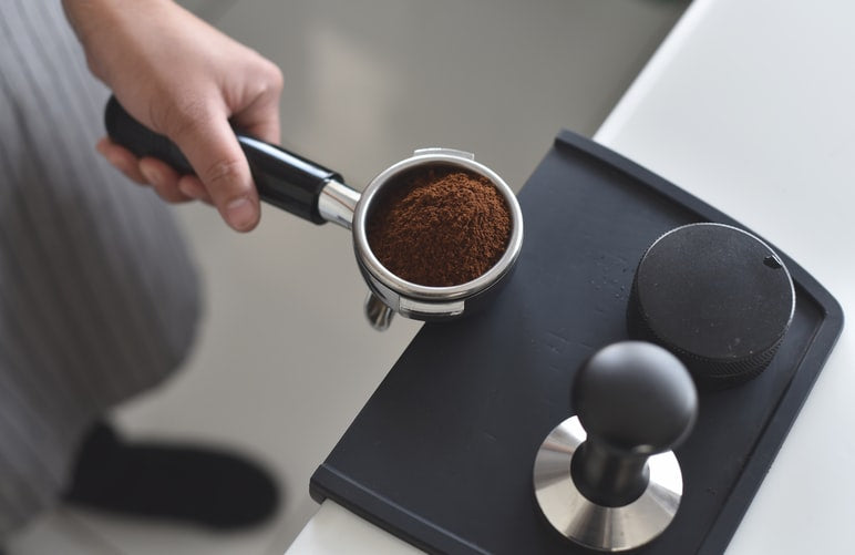 coffee grounds in an espresso maker