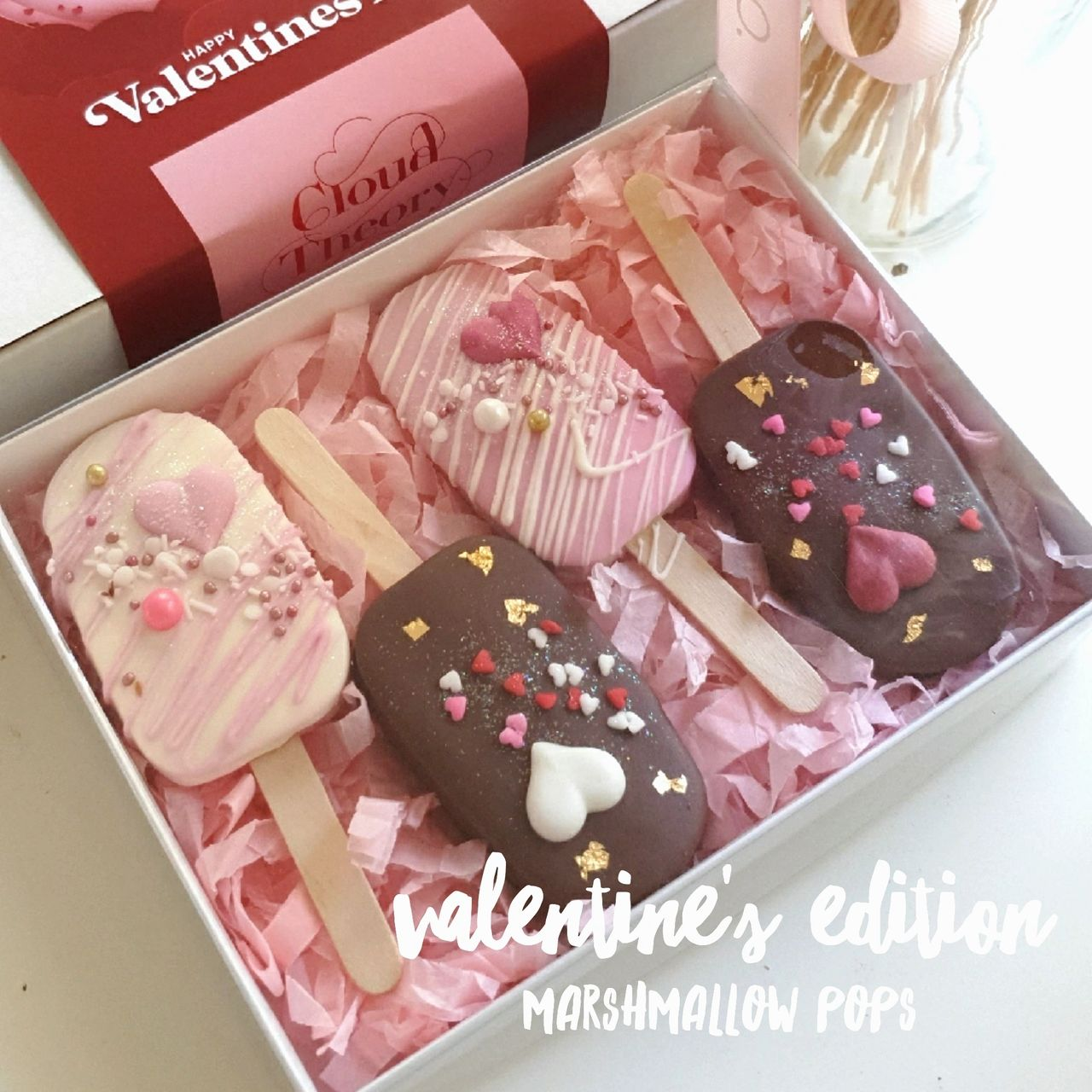 Valentine's Day Edition Marshmallow Popsicles -Take your Valentine to Cloud 9 with these dreamy marshmallow popsicles.  Each marshmallow pop is beautifully decorated and dipped in white chocolate and milk chocolate.