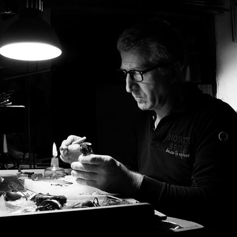 Giuseppe Mandile an Italian artisan with craftsmanship making silver 925 and bronze earrings at his workshop in Naples