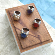 Collection of Stones with Sterling Silver and Bronze Rings