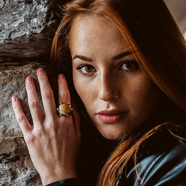 Redhead model showing sterling silver ring with gemstone