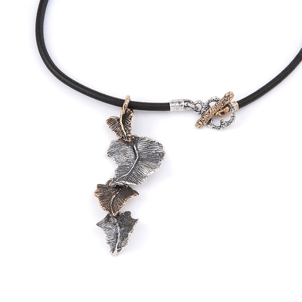 Silver Bronze Ivy Vine Pendant on Black strap necklace with T bar fastening