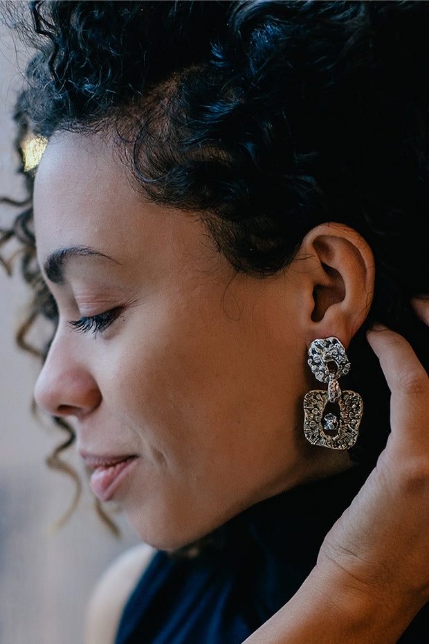 Frizzy hair model showing her Italian silver and bronze earrings