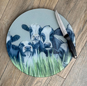 Friesian Cows Through Grass Round Worktop Saver