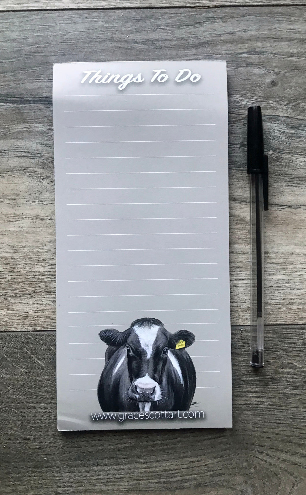 Cow with tag to do list notepad