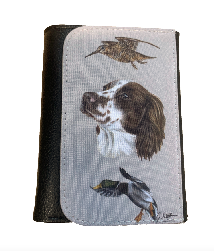 spaniel with pheasant brown spaniel