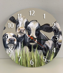 Friesian Cows Through Grass Clock