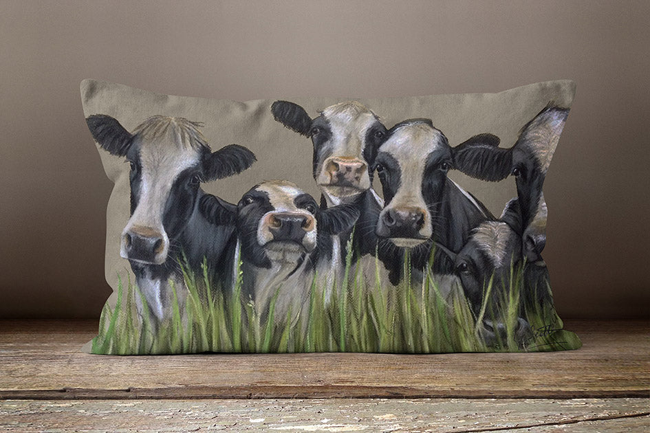 Row Of Friesian Cows Through Grass Oblong Cushion