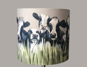 Row of Friesian Cows through Grass Lampshade