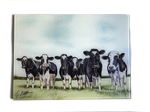 Row of Friesian Cows Through Grass - 2 Worktop Saver