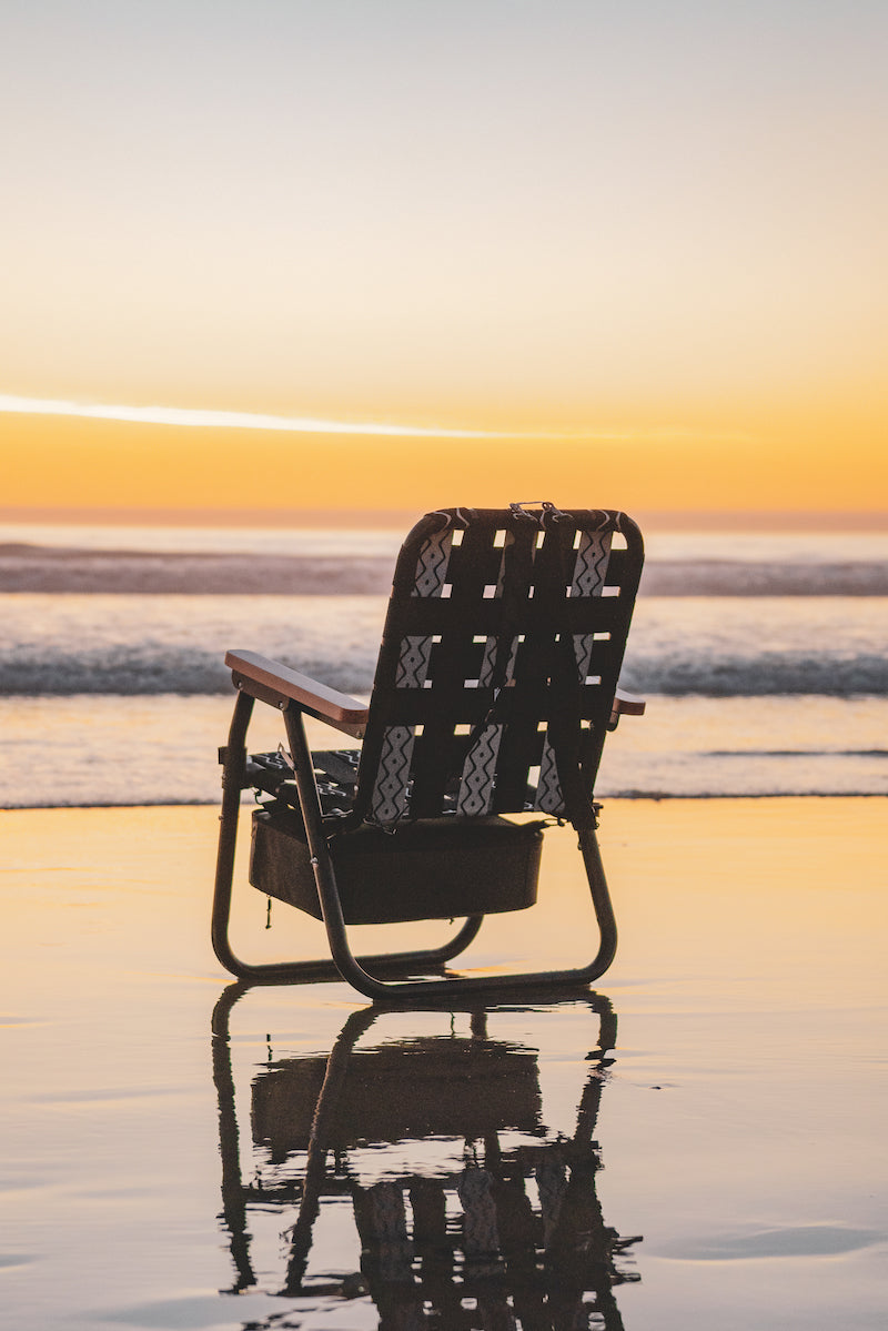 PARKIT Voyager Outdoor Beach Chair in Slate at the beach during sunset