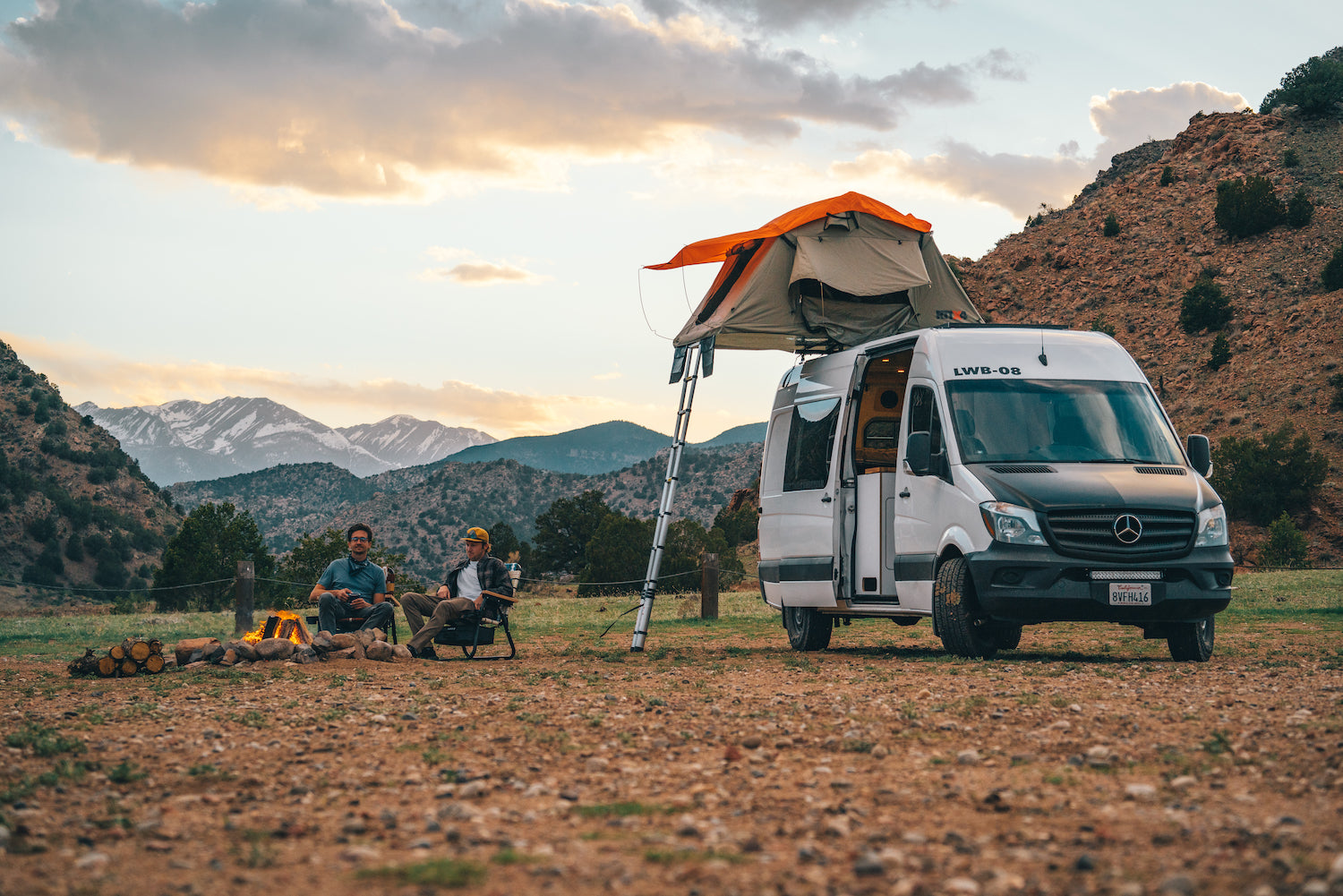 Two guys camping with Parkit chairs and a converted mercedes sprinter van