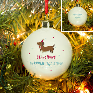 personalised dachshund through the snow christmas bauble