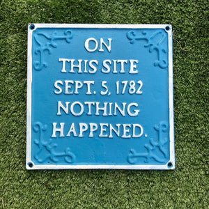 cast iron on this site nothing happened garden sign